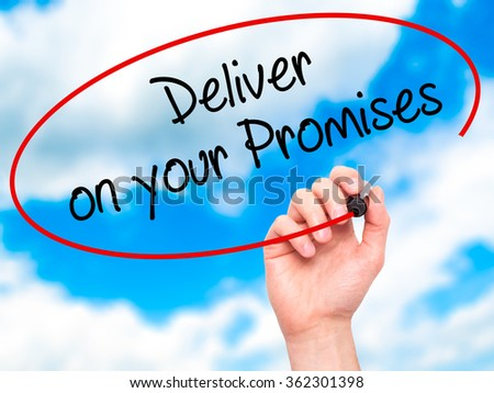 Man Hand writing Deliver on your Promises with black marker on visual screen. Isolated on background. Business, technology, internet concept. Stock Photo - stock photo