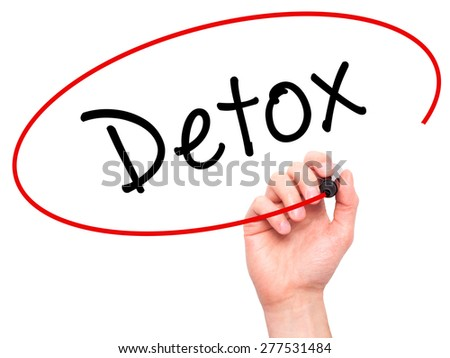 Man Hand writing Detox with marker on transparent wipe board. Isolated on white. Health, internet, technology concept.  Stock Photo