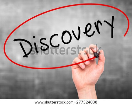 Man Hand writing Discovery with marker on transparent wipe board. Isolated on grey. Business, internet, technology concept.  Stock Photo - stock photo