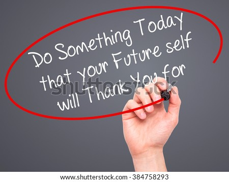 Man Hand writing Do Something Today that your Future self will Thank You for with black marker on visual screen. Isolated on background. Business, technology, internet concept. Stock Photo