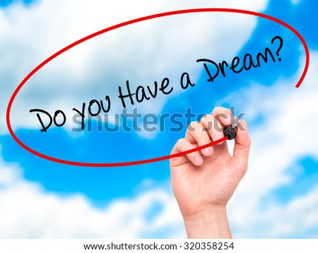 Man Hand writing Do you Have a Dream? with black marker on visual screen. Isolated on sky. Business, technology, internet concept. - stock photo