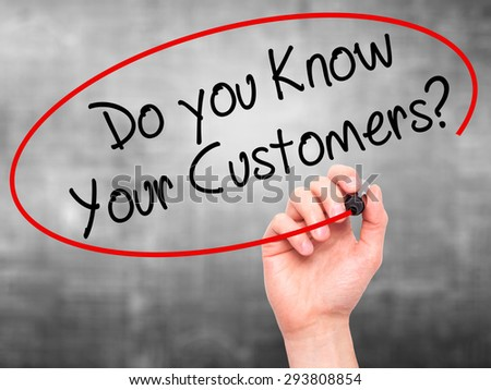 Man Hand writing Do you Know your Customers? with black marker on visual screen. Isolated on grey. Business, technology, internet concept. Stock Photo - stock photo