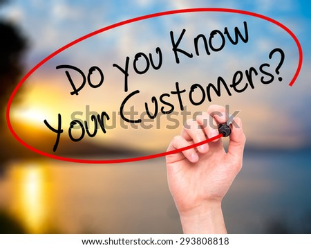 Man Hand writing Do you Know your Customers? with black marker on visual screen. Isolated on nature. Business, technology, internet concept. Stock Photo - stock photo