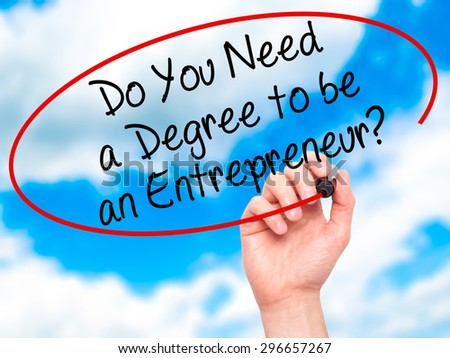 Man Hand writing Do You Need a Degree to be an Entrepreneur? with black marker on visual screen. Isolated on sky. Business, technology, internet concept. Stock Photo
