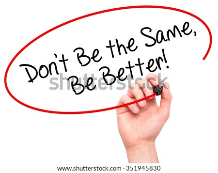 Man Hand writing Don't Be the Same, Be Better! with black marker on visual screen. Isolated on background. Business, technology, internet concept. Stock Photo - stock photo