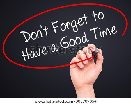 Man Hand writing Don't Forget to Have a Good Time with black marker on visual screen. Isolated on black. Business, technology, internet concept. Stock Photo - stock photo