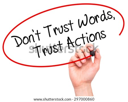 Man Hand writing Don't Trust Words, Trust Actions with black marker on visual screen. Isolated on white. Business, technology, internet concept. Stock Photo - stock photo