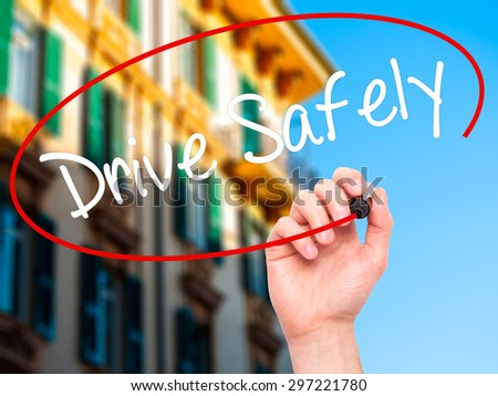Man Hand writing  Drive Safely with black marker on visual screen. Isolated on city. Business, technology, internet concept. Stock Photo - stock photo