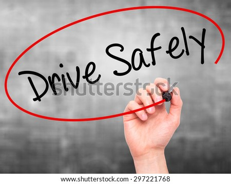Man Hand writing  Drive Safely with black marker on visual screen. Isolated on grey. Business, technology, internet concept. Stock Photo - stock photo