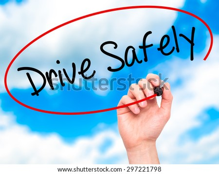 Man Hand writing  Drive Safely with black marker on visual screen. Isolated on sky. Business, technology, internet concept. Stock Photo - stock photo