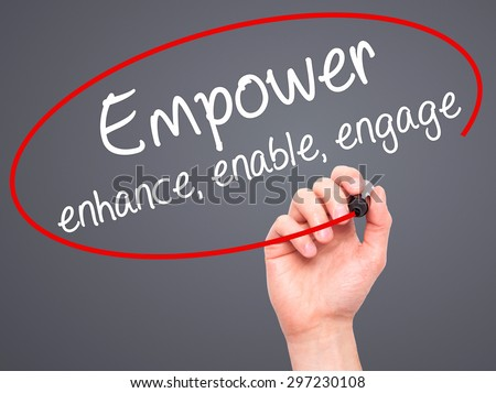 Man Hand writing Empower enhance, enable, engage with black marker on visual screen. Isolated on grey. Business, technology, internet concept. Stock Photo - stock photo