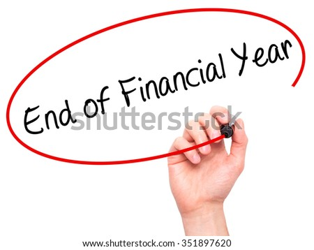 Man Hand writing End of Financial Year with black marker on visual screen. Isolated on background. Business, technology, internet concept. Stock Photo - stock photo