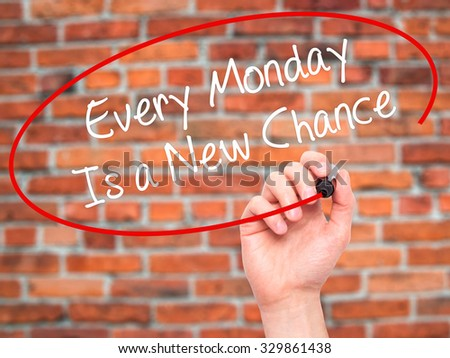 Man Hand writing Every Monday Is a New Chance with black marker on visual screen. Isolated on bricks. Business, technology, internet concept. Stock Photo - stock photo