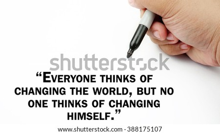 "Man Hand writing ""everyone thinks of changing the world, but no one thinks of changing himself"" with black marker on visual screen. Isolated white background. Business, technology, internet concept."