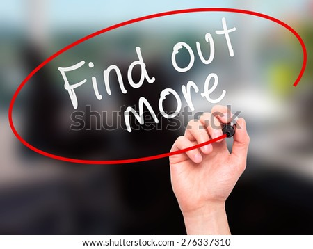 Man Hand writing Find out more with marker on transparent wipe board. Isolated on office. Business, internet, technology concept.  Stock Photo - stock photo