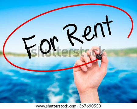 Man Hand writing For Rent with black marker on visual screen. Isolated on background. Business, technology, internet concept. Stock Photo - stock photo