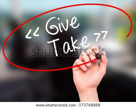 Man Hand writing Give - Take with black marker on visual screen. Isolated on background. Business, technology, internet concept. Stock Photo