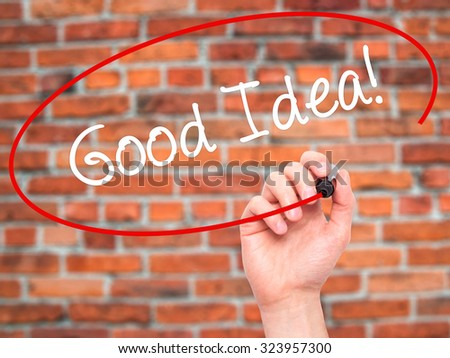 Man Hand writing Good Idea! with black marker on visual screen. Isolated on bricks. Business, technology, internet concept. Stock Photo - stock photo