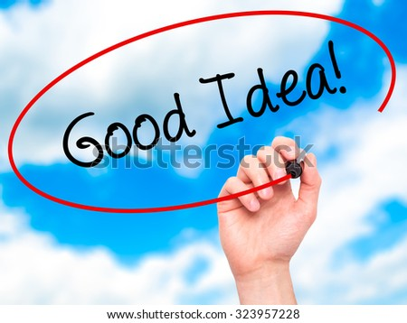 Man Hand writing Good Idea! with black marker on visual screen. Isolated on sky. Business, technology, internet concept. Stock Photo - stock photo