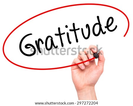 Man Hand writing Gratitude with black marker on visual screen. Isolated on white. Business, technology, internet concept. Stock Photo - stock photo
