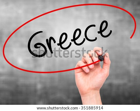 Man Hand writing Greece  with black marker on visual screen. Isolated on background. Business, technology, internet concept. Stock Photo