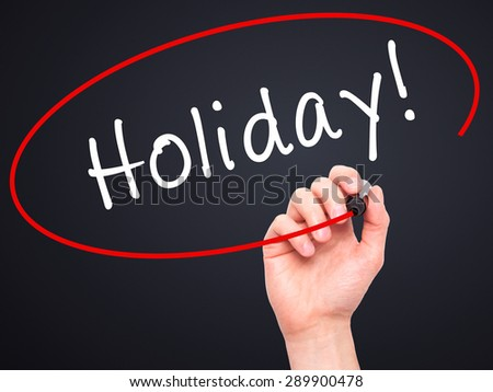 Man Hand writing Holiday! with black marker on visual screen. Isolated on black. Business, technology, internet concept. Stock Image - stock photo
