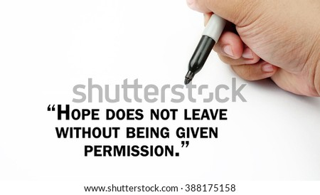 "Man Hand writing ""hope does not leave without being given permission"" with black marker on visual screen. Isolated white background. Business, technology, internet concept. Stock Photo"