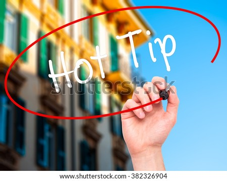 Man Hand writing Hot Tip with black marker on visual screen. Isolated on background. Business, technology, internet concept. Stock Photo - stock photo