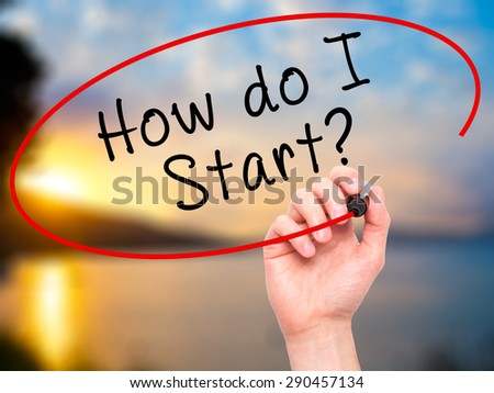Man Hand writing How do I Start? with black marker on visual screen. Isolated on nature. Learn, technology, internet concept. Stock Image - stock photo