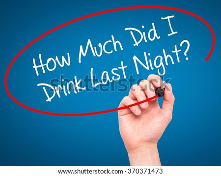Man Hand writing How Much Did I Drink Last Night? with black marker on visual screen. Isolated on background. Business, technology, internet concept. Stock Photo