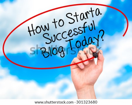 Man Hand writing How to Start a Successful Blog Today? with black marker on visual screen. Isolated on sky. Business, technology, internet concept. Stock Photo