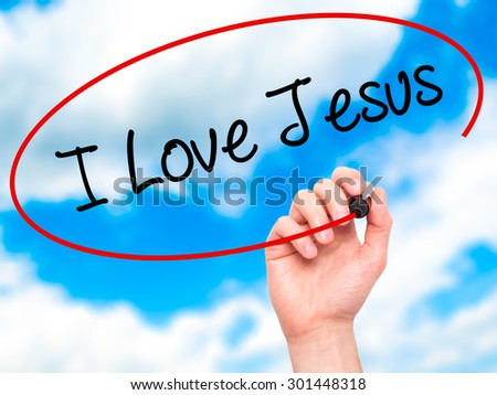 Man Hand writing I Love Jesus with black marker on visual screen. Isolated on sky. Business, technology, internet concept. Stock Photo - stock photo