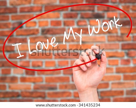Man Hand writing I Love My Work with black marker on visual screen. Isolated on bricks. Business, technology, internet concept. Stock Photo - stock photo