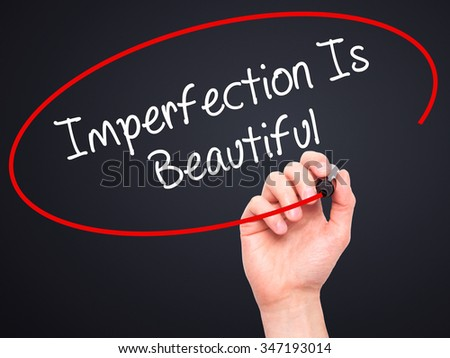Man Hand writing Imperfection Is Beautiful with black marker on visual screen. Isolated on background. Business, technology, internet concept. Stock Photo