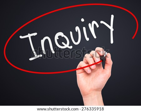 Man Hand writing Inquiry with marker on transparent wipe board. Isolated on black. Business, internet, technology concept.  Stock Photo - stock photo