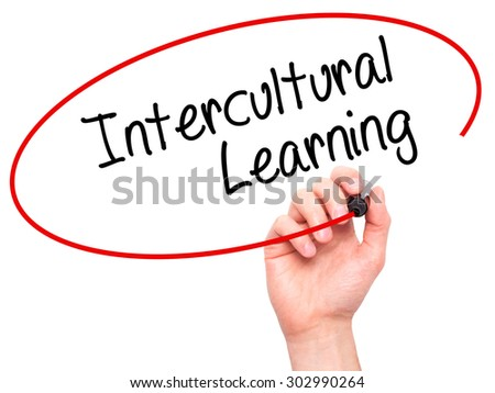Man Hand writing Intercultural Learning with black marker on visual screen. Isolated on white. Business, technology, internet concept. Stock Photo - stock photo