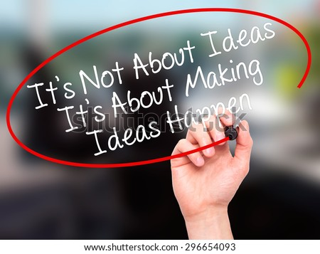 Man Hand writing It's Not About Ideas Its About Making Ideas Happen  with black marker on visual screen. Isolated on office. Business, technology, internet concept. Stock Photo