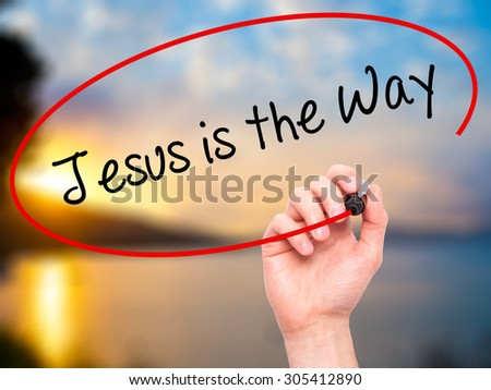 Man Hand writing Jesus is the Way with black marker on visual screen. Isolated on nature. Business, technology, internet concept. Stock Photo - stock photo