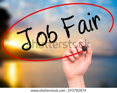 Man Hand writing Job Fair with black marker on visual screen. Isolated on nature. Business, technology, internet concept. Stock Image - stock photo
