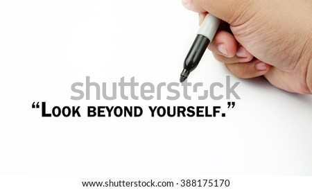 "Man Hand writing ""look beyond yourself"" with black marker on visual screen. Isolated white background. Business, technology, internet concept. Stock Photo"