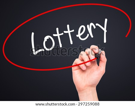 Man Hand writing Lottery  with black marker on visual screen. Isolated on black. Business, technology, internet concept. Stock Photo - stock photo