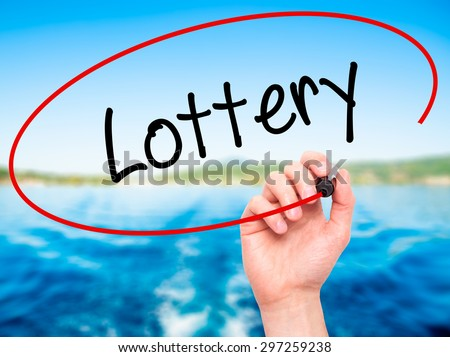 Man Hand writing Lottery  with black marker on visual screen. Isolated on nature. Business, technology, internet concept. Stock Photo - stock photo