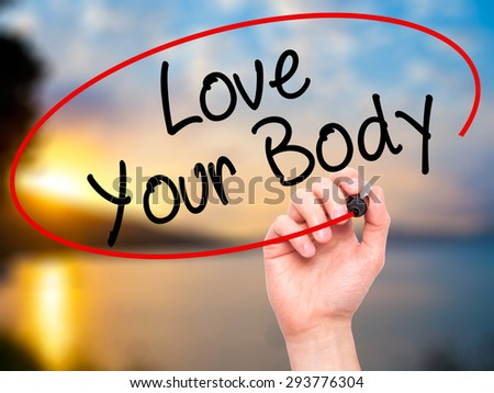 Man Hand writing Love Your Body with black marker on visual screen. Isolated on nature. Business, technology, internet concept. Stock Image  - stock photo