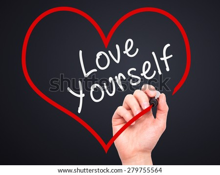 Man Hand writing Love Yourself with marker on transparent wipe board, inside heart shape. Isolated on black. Business, internet, technology concept. Stock Photo - stock photo
