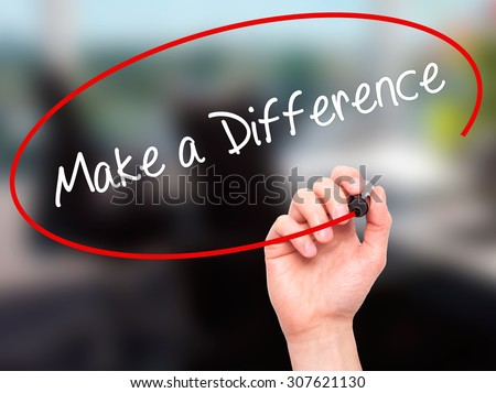 Man Hand writing Make a Difference with black marker on visual screen. Isolated on office. Business, technology, internet concept. Stock Photo - stock photo