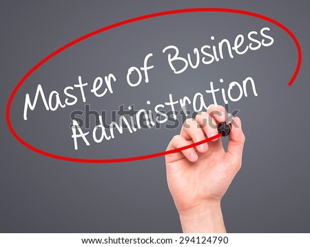 Man Hand writing Master of Business Administration with black marker on visual screen. Isolated on grey. Business, technology, internet concept. Stock Photo