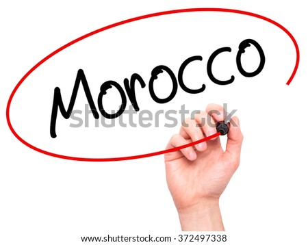Man Hand writing Morocco  with black marker on visual screen. Isolated on background. Business, technology, internet concept. Stock Photo - stock photo