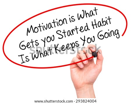 Man Hand writing Motivation is What Gets you Started Habit Is What Keeps You Going with black marker on visual screen. Isolated on white. Business, technology, internet concept. Stock Photo - stock photo