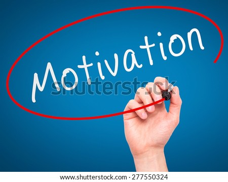 Man Hand writing Motivation with marker on transparent wipe board. Isolated on blue. Business, internet, technology concept.  Stock Photo - stock photo