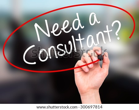 Man Hand writing Need a Consultant? with black marker on visual screen. Isolated on grey. Business, technology, internet concept. Stock Photo - stock photo
